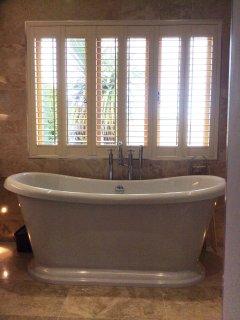 En-suite bathroom with bath & shower