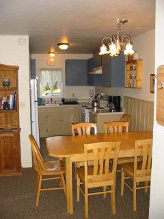 Close up of dining area and kitchen view 2