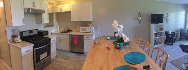 'New' butcher block Island, cabinets, floors, appliances, countertops.