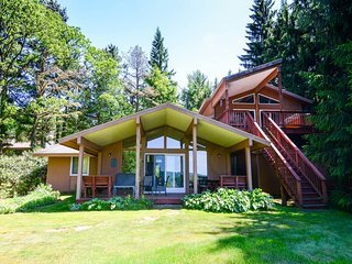 An ever-changing kaleidoscope of nature's best colors will enchant you at Piece of Heaven! This home is the perfect perch to watch the seasons explode to life.