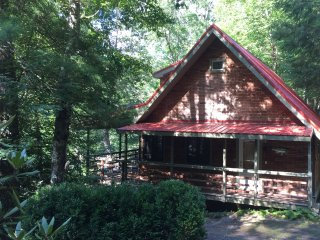 Beautiful tin roof and wrap around porch, sitting high above the river.