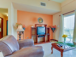 Oceanfront dog-friendly home with shared pool near restaurants & attractions!