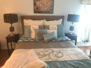 Master bedroom, brand new memory foam mattress, luxurious linens, walk in closet