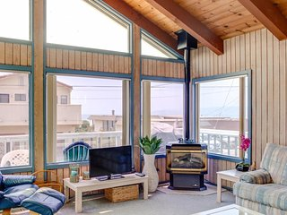 Hit the beach from this spacious home w/ enclosed yard, & deck with ocean view