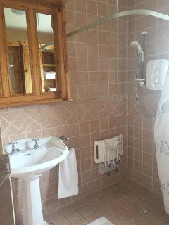 Walk-in shower with seat to support any persons who has difficulty accessing normal shower