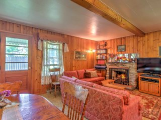 The living room has sofas, a candle-lit fireplace, and entertainment options.
