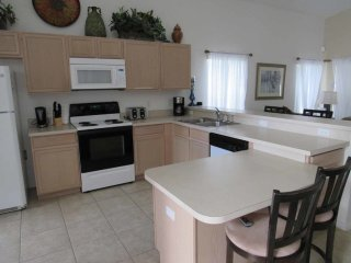 Hampton Lakes 5/4 Pool Home property, fully furnished, with full kitchen, and