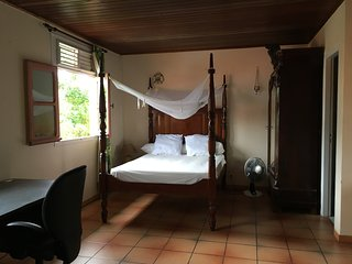 Spacious studio with superb colonial bed & open kitchen on terrace, Creole villa