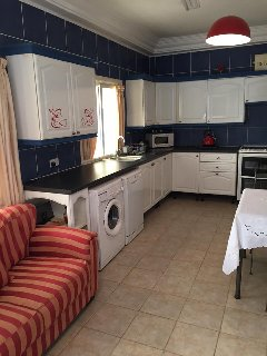 Kitchen with microwave, washing machine, dish washer