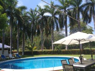 La casa de las palmeras con vista al campo de golf para hasta 15 personas