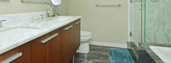 Master bathroom: double sinks, a walk in shower and a deep soaker tub.