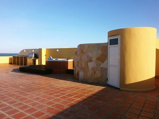 Your private terrace with gazebo, hot tub, BBQ-grill and outdoor shower
