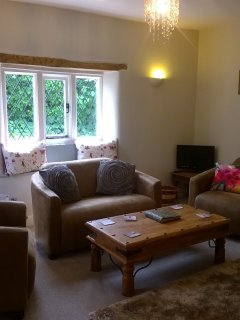 Cosy sitting room with, woodburner, TV and DVD player