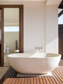 Penthouse bathroom with bath tub