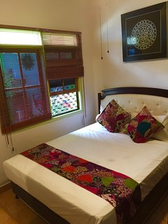 Queen bedroom with pool view,wardrobe,TV,ceiling fans, fly screen windows