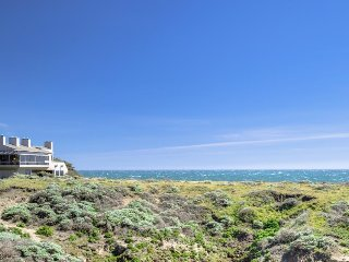 Large oceanfront home w/ hot tub, shared pool, & large deck. Dogs welcome!