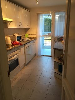 Fully equipped kitchen, and utility room leading off, to outside poolside terrace.