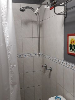 Bathroom has hand-held sprayer.  Plumbed hot water at both shower and sink.  (rare here!)