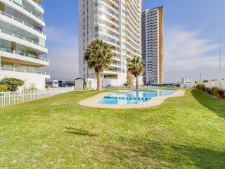 Beachfront condo with shared pool and stunning ocean views!