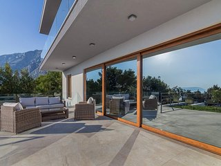 Comfortable terrace with double view - in mirror in glass wall and real sea view