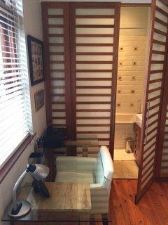 Desk in bedroom, opening up to hidden bathroom