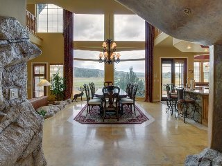 Luxurious lakefront home with a view, gourmet kitchen, & hot tub w/ waterfall