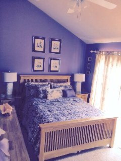 Master bedroom has deck overlooking the courtyard and pool. ps. This room is pale lavender!