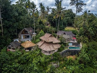 Aerial photo of the whole property. 3 bungalows, kitchen, dining and a pool