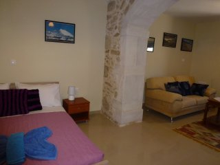 Lounge and bedroom in stone house recently renovated. Quiet and comfortable with modern comforts.