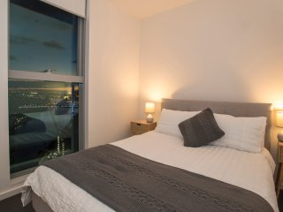 Main bedroom with view of city and Yarra River. Queen size bed