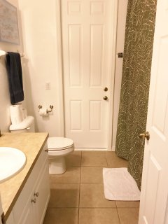 Guest Bath (located in hall with 3 guest bedrooms...has door out to pool)