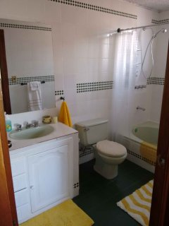 Queen en-suite bathroom with abundant hot water and light.