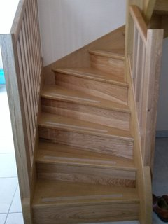 Beautiful oak staircase with hand rails either side...