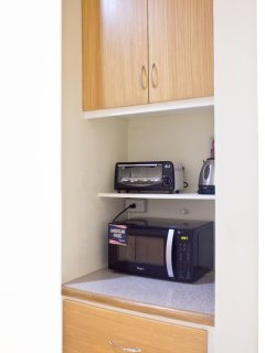 microwave, toaster, electric kettle, rice cooker and one burner electric stove