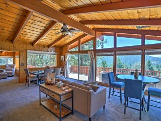 The living room features floor-to-ceiling windows with incredible views.