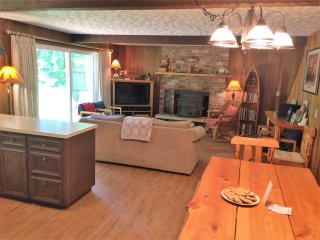Enjoy the open living area with cozy wood stove and access to the back deck with river views!