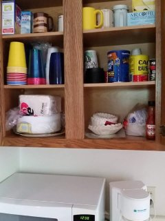 Paper plates, napkins, cups, coffee, filters, misc items.