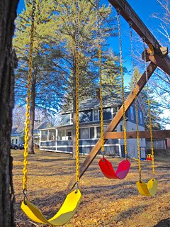 Let the little ones play on the swingset under a watchful eye