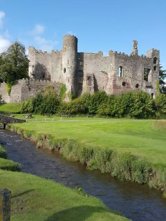 Laugharne Castle and Dylan Thomas Boathouse, just 11 miles away