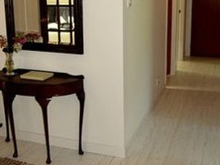 White wooden flooring throughout