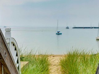 Beachfront condo w/ garden patio, walk to restaurants & galleries, dog OK!