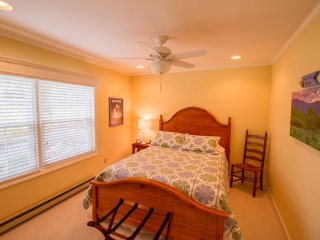 Large queen bedroom with all the amenities you need for a good night's rest.