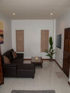 Spacious living area with flat screen TV and wifi throughout.