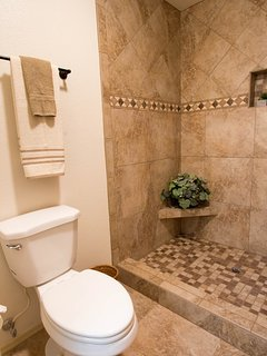 Newly updated Master Shower with custom tile work and flooring.