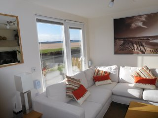 Luxury beachfront chalet with stunning panoramic views across Belhaven Bay