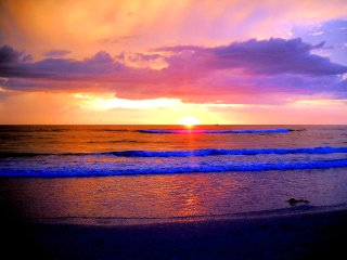 VIEW MAGNIFICENT SUNSETS OVER THE HORIZON OF CLEARWATER BEACH FL.