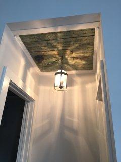 Original porch ceiling in the master bedroom