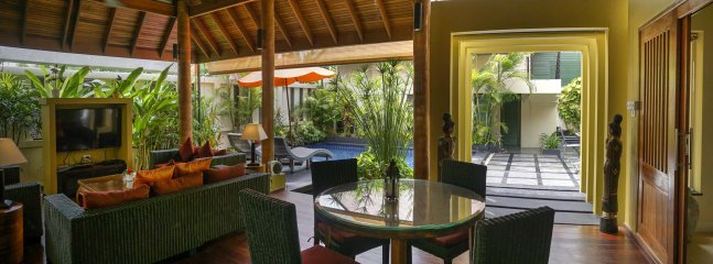 Tropical Dining and Living area looks out to pool