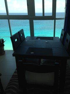 Your one bedroom penthouse dining area with gorgeous ocean view!