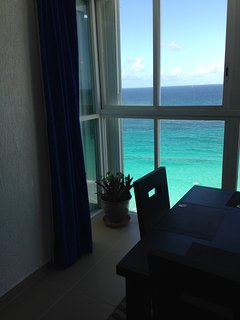 Your ocean view from your dining room in yourone bedroom penthouse.